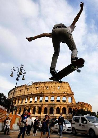 Jacopo Ferraro performs skateboard tricks near the Coliseum.