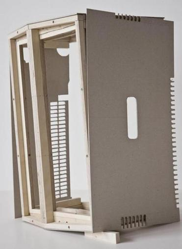 Sarah Bapst displays cardboard and plywood re-creations of an abandoned air conditioning unit.