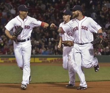 Jacoby Ellsbury (left) gets a fist-bump from Jonny Gomes after making two putouts in the top of the eighth inning.