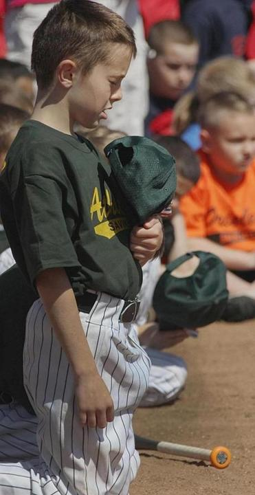 A young player paused for reflection during Savin Hill Little League ceremonies honoring Martin Richard on Saturday.