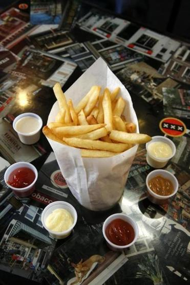 French fries come with dipping sauces.