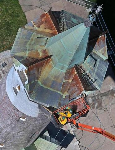 A crew from the Chapman Waterproofing Co. power washed paint off the roof of Fort Hill Tower earlier this week.