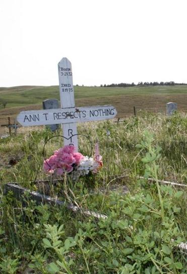 A cross adorned a grave at the Wounded Knee National Historic Landmark in South Dakota.