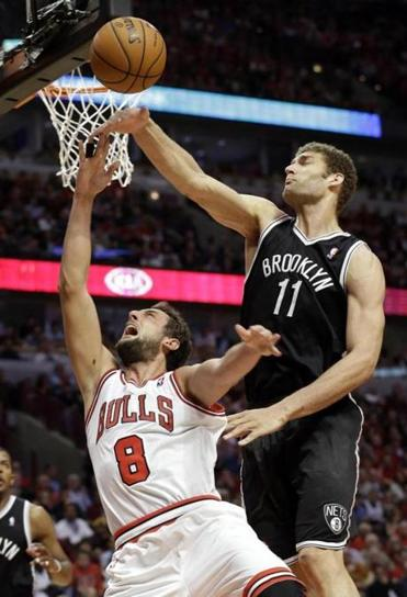 Brooklyn center Brook Lopez swats away a layup attempt by Chicago's Marco Belinelli.