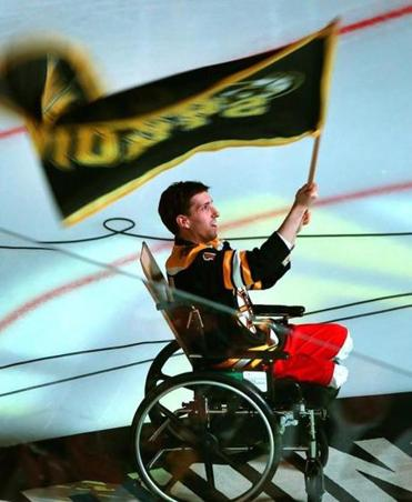 In an emotional ceremony, Jeff Bauman, who lost his legs in the Marathon bombings, waved a Boston Strong flag before Game 2 of the Bruins' series with Toronto.