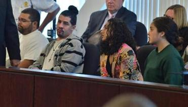 Attorney David Bernardin spoke with Antonio Matos, seated with co-defendants Hector Baez-Cruz, Erianiss Murillo, and Allegra Martinez.