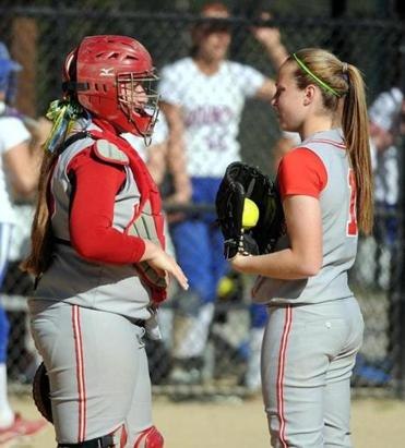Silver Lake sisters Alex (left) and Maddy Barone have a meeting on the mound.