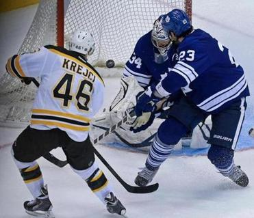 David Krejci finishes off his hat trick by slipping one past Leafs goaltender James Reimer and defenseman Ryan O'Byrne at 13:06 of overtime.
