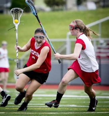 Emily Loprette, No. 9 (on left) and her Watertown girls lacrosse team are out to a 14-0 start in just the third year of the program's existence.