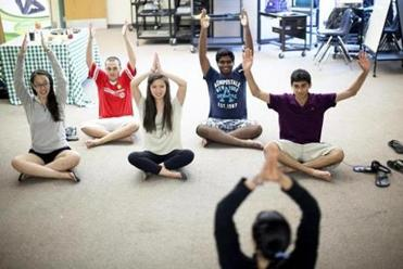 From left, Lisa Lee, Zach Strohmeyer, Joyce Lo, Pruthvi Kilaru and Akshay Daftardar took a yoga class given by Lorraine Shedoudi of Lexington Power Yoga.