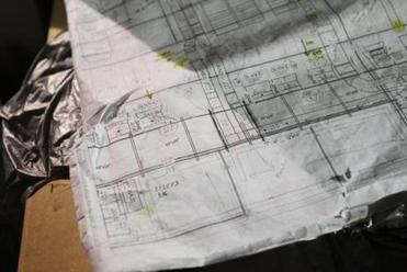 blueprints of the museum renovation.