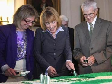 From left, House Speaker Terie Norelli, Governor Maggie Hassan, and David Berry cut the birthday cake Tuesday in Concord, N.H.