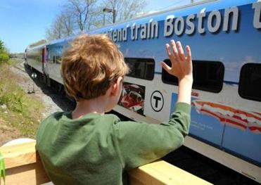 Stephen Bilski, 11,  of Yarmouth waved at the CapeFlyer as it made a trial run from Boston to Hyannis Thursday.
