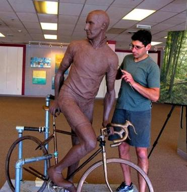 Sculptor Michael Alfano at work in a Westborough storefront.