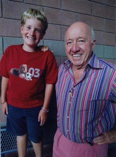 Bud Collins, right with Nicholas Pantages at a Grand Slam stop.