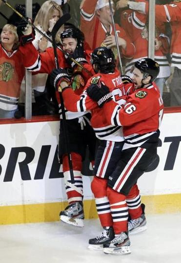Brent Seabrook (left) celebrates with teammates after his goal gave the Blackhawks a spot in the Western finals.