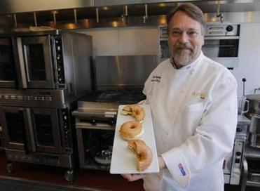 Stan Frankenthaler, Dunkin' Donuts executive chef, with his sandwich creation.