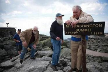 Harold Addison grabbed the summit sign as Gerry Wright, his climbing companion that night in 1963, and savior Guy Gosselin approached.