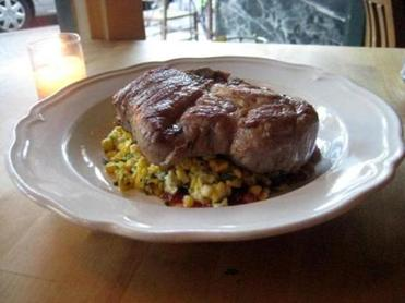 Pork chop with corn pudding and tomato jam.