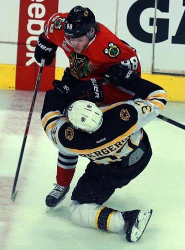 It was a collision of the stars as Chicago's Patrick Kane barrels into Patrice Bergeron.
