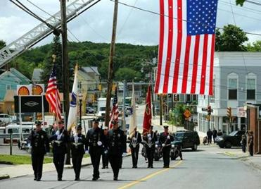 A procession traveled from downtown Hudson to the funeral of Paul Cellucci, who died June 8. He was 65.