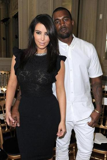 Kim Kardashian and Kanye West: Successful seekers of attention, now accessorized.