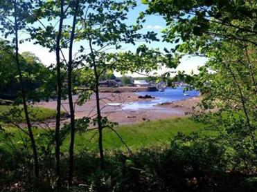 A trail on the monastery grounds overlooks the tidal Kennebunk River Harbor.