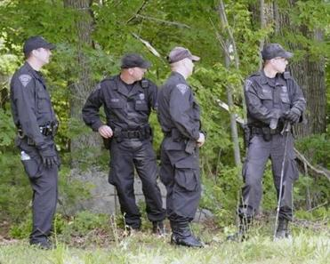 State Police searched a wooded area in North Attleboro Wednesday.