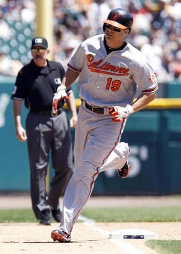 Baltimore's Chris Davis rounds the bases after hitting a two-run shot to left field in the fourth inning.