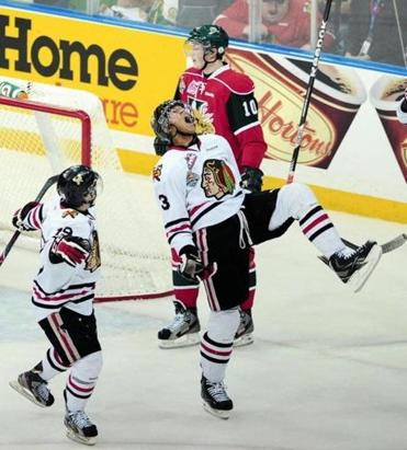 Seth Jones, center, is expected to be a top selection in the NHL draft.
