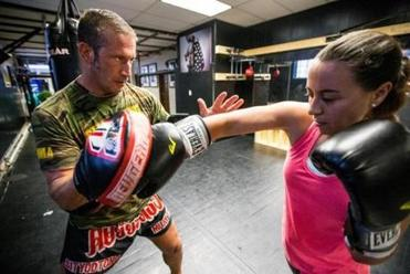 Mark DellaGrotte and Erica Rodrigues at Sityodtong Muay Thai Academy in Somerville.