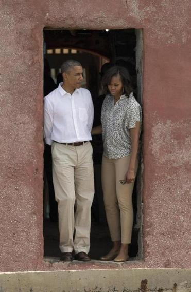 "The Obamas stood on Thursday at Goree Island's ""Door of No Return,"" where many shackled slaves left Africa, inching across a plank to the hull of a waiting ship."