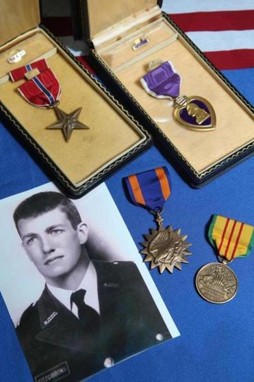The Benedettos of Wakefield wrapped the medals in a miniature American flag and mailed them to a cousin of Fitzgibbons.