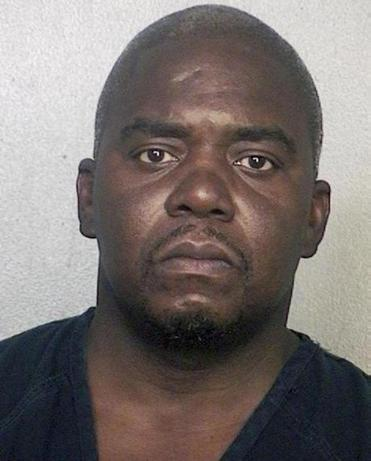 Ernest Wallace turned himself in on Friday in Miramar, Fla., after learning he was wanted in the Aaron Hernandez case.