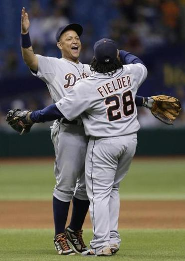 Miguel Cabrera (left) is smiling after his 4-for-4 outing, and a Detroit win.