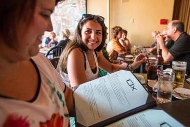 Maria Pacheco (left) and her daughter Kayla, 13, ponder their options at the Blue Ox restaurant in downtown Lynn.