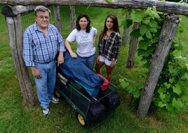Matt and Ruth Lincoln and daughter Myrna at their Mansfield home, with the wagon they usually take to the Esplanade. Ruth and Myrna say Matt may go without them this year.