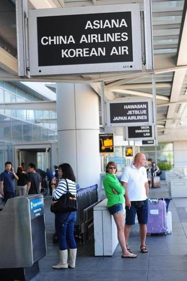 People were seen outside of the international terminal at the San Francisco airport after a plane arriving from South Korea crashed.