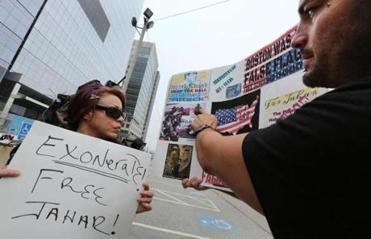 Karina Figueroa (left) of New York, and Duke LaTouf of Las Vegas, stood outside the courthouse in support of Tsarnaev.
