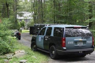 Investigators remained at the home in Middleborough where police shot one man after a woman was shot dead.