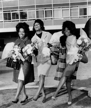 "Martha and the Vandellas (from left, Betty Kelly, Martha Reeves, and Rosalind Ashford), pictured here at London Airport in 1964, the year they recorded ""Dancing in the Street."""