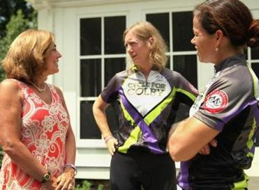 Tracy Schofield, left, chatted with Pan-Mass Challenge riders Allison Washkurak, middle, and Maureen Pelligrini.