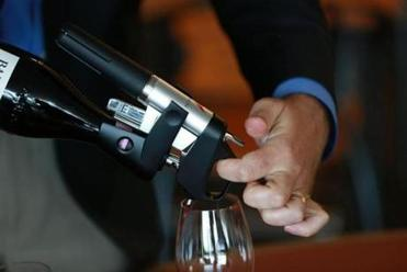 The Coravin device allows wine lovers to decant a glass from a bottle and still keep the rest of the beverage in pristine condition.