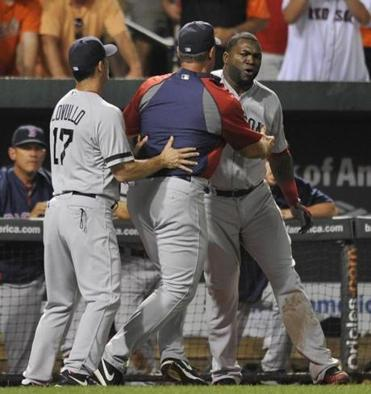 David Ortiz, right, had to be restrained following his dugout explosion on Saturday.
