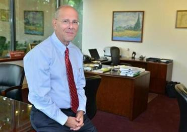 CEO Howard Grant is working to widen Lahey Health's network.