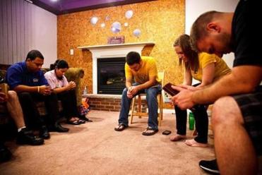A prayer meeting at the apartment shared by the TrueVine Church team.