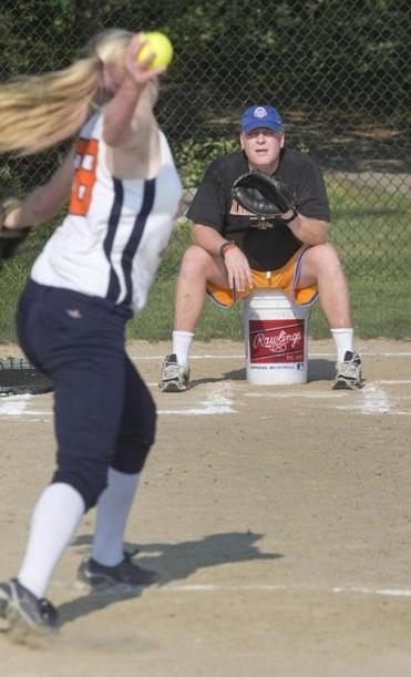 Curt Schilling catches his daughter, Gabby, during a practice.
