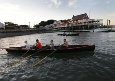 The men and women of the Boston Irish Currach Rowing Club practice near the Quincy Yacht Club in Houghs Neck for their regatta Sunday at Carson Beach in South Boston.