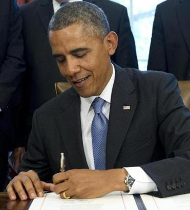 President Obama expressed his satisfaction with signing the measure to keep student loan interest rates low.