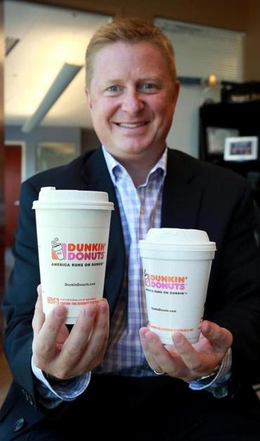 Scott Murphy of Dunkin' Donuts with the new-style cups.
